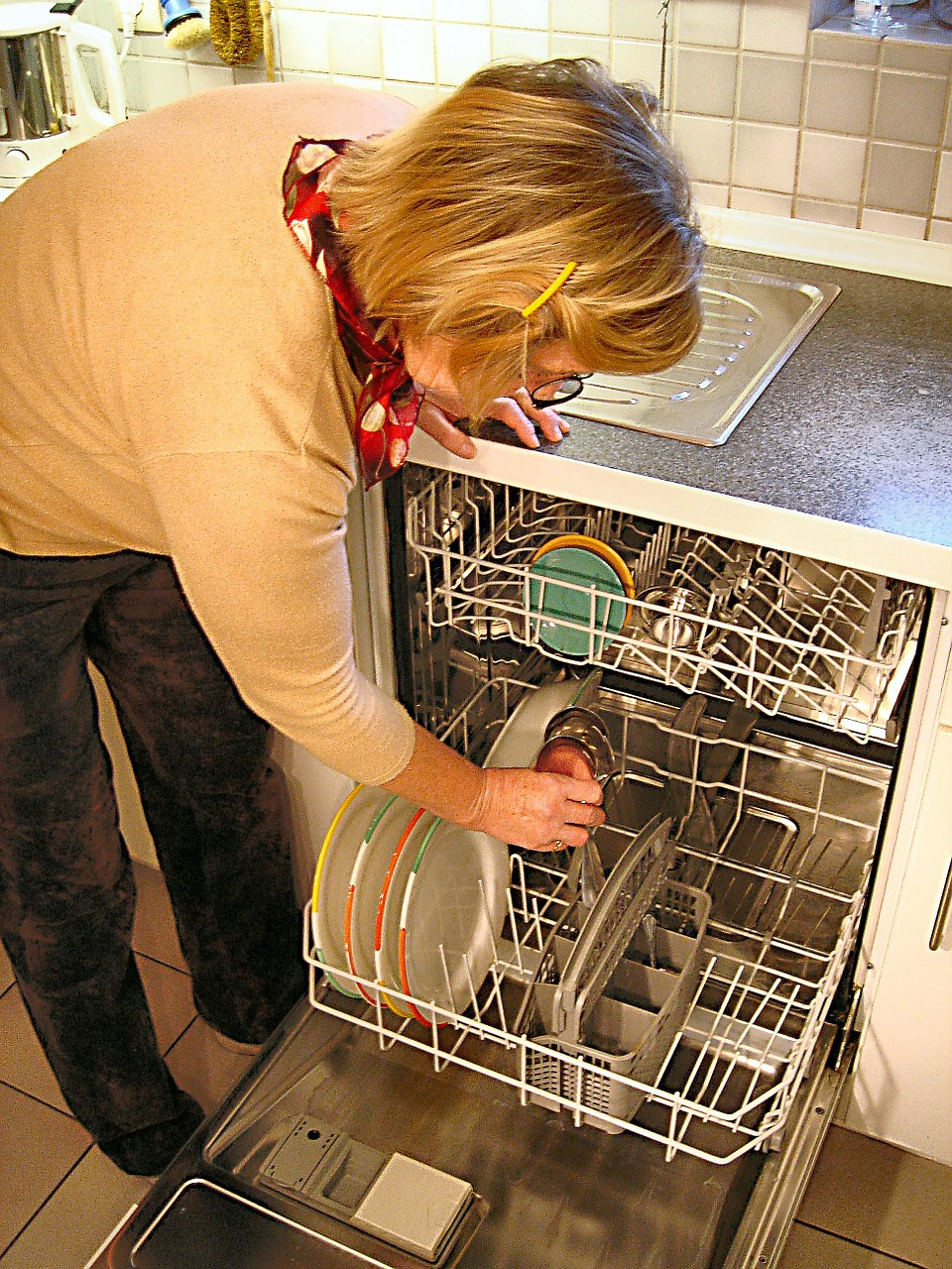 lady opening dishwasher